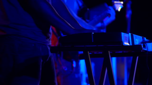 musician hands playing keyboard at concert - musical instrument string stock videos & royalty-free footage
