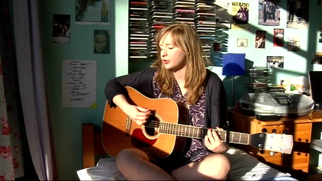 musician milla traylen playing guitar and interview; england: london: dulwich: int musician, milla traylen, sitting in her bedroom performing song on... - dulwich stock videos & royalty-free footage