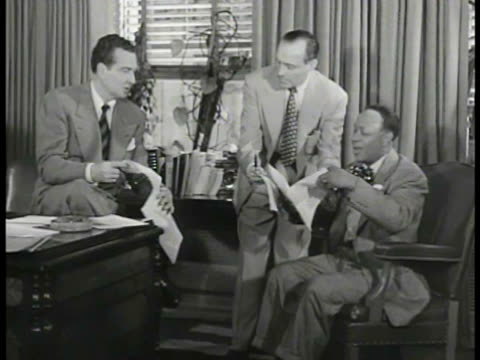 musician phil harris w/ comedians jack benny and eddie 'rochester' anderson in office looking over scripts ms jack benny looking down reading then... - reading stock videos & royalty-free footage