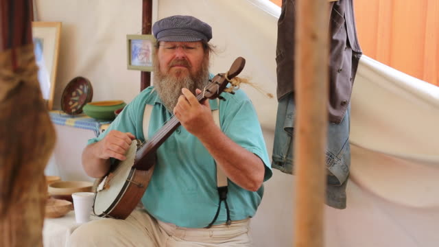 musician playing a banjo at the delaware county fair - bluegrass music stock videos and b-roll footage