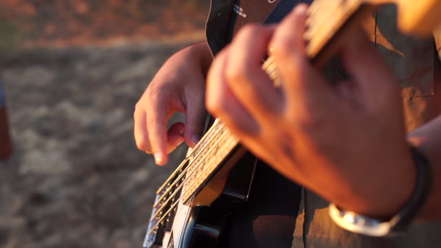 musician playing a bass guitar - bass guitar stock videos & royalty-free footage