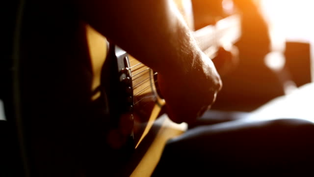 musician playing acoustic guitar - hobby video stock e b–roll