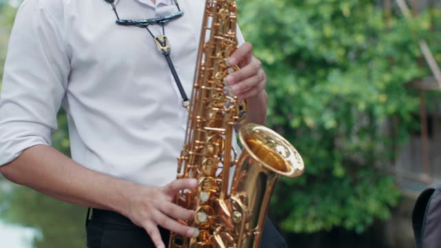 musician playing alto saxophone - alto saxophone stock videos and b-roll footage