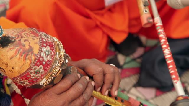 musician playing folk music in suraj kund mela, faridabad, haryana, india - tradition stock videos & royalty-free footage