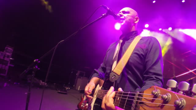 POV Musician playing guitar and singing on stage