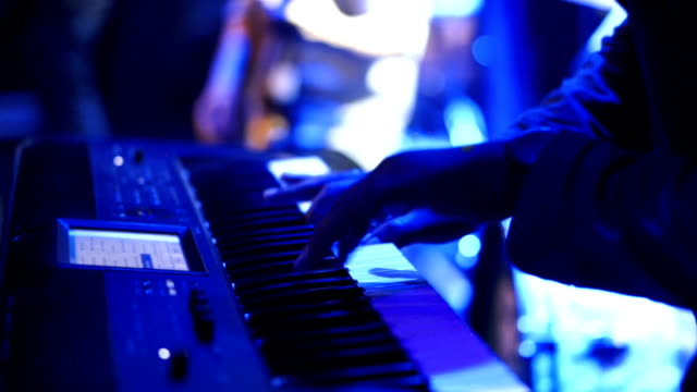 musician playing keyboard at a concert - synthesizer stock videos & royalty-free footage