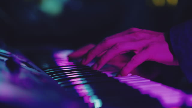 musician playing keyboard in concert. bangkok, thailand. - synthesizer stock videos & royalty-free footage