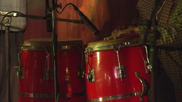 CU, musician playing on bongos, Cuba