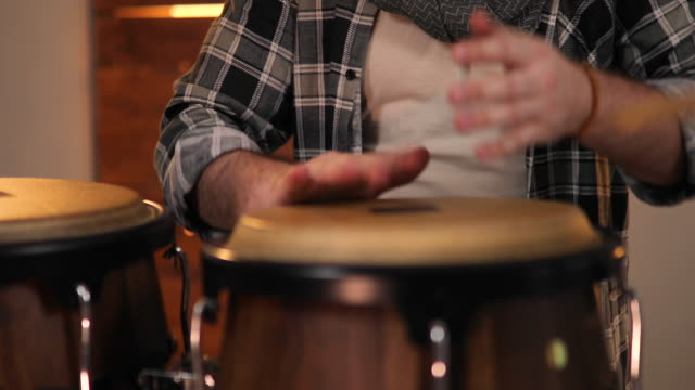 Musician Playing on Drums