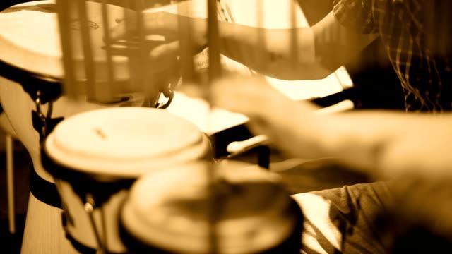 Musician Playing Percussion Sephia