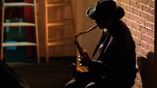 musician playing saxophone backstage - blues stock videos & royalty-free footage