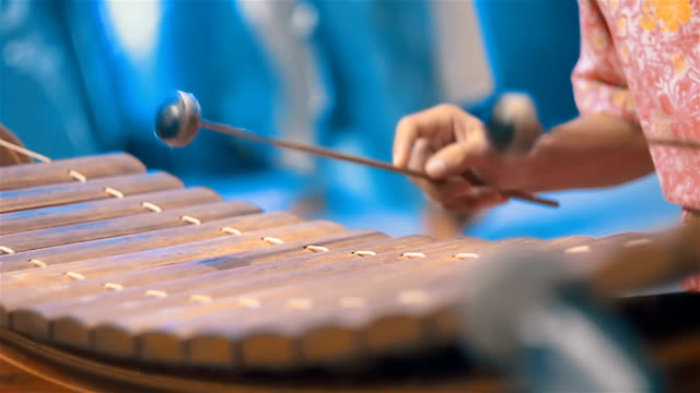 musician playing thai xylophone in orchestra traditional music - thai ethnicity stock videos & royalty-free footage