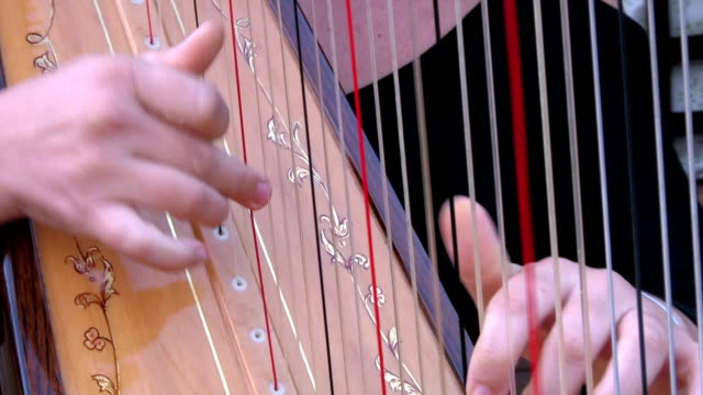 musician playing the harp. - harp stock videos & royalty-free footage