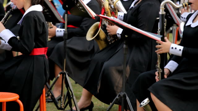 musician playing the trombone in orchestra - saxophone stock videos and b-roll footage