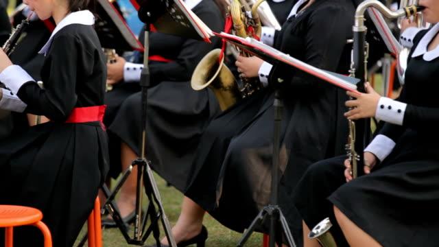 musician playing the trombone in orchestra - endast en flickbaby bildbanksvideor och videomaterial från bakom kulisserna