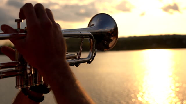 musician playing the trumpet on a lake - trumpet stock videos & royalty-free footage