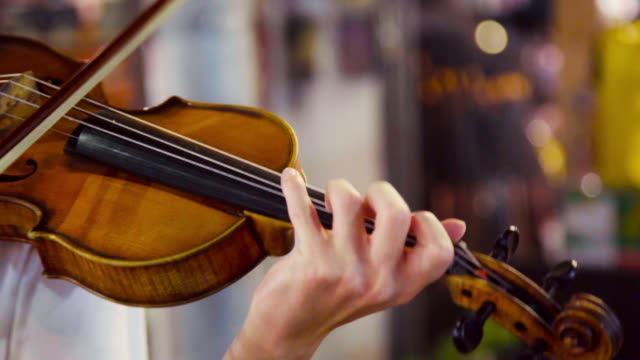 musician playing violin at street night market in thailand. - violin stock videos & royalty-free footage