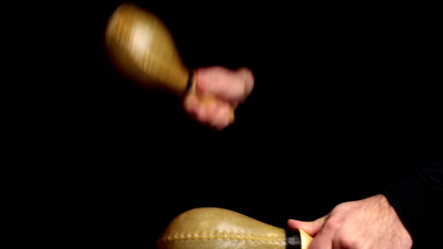 musician plays a rhythm with the maracas, percussion instrument - maraca stock videos & royalty-free footage