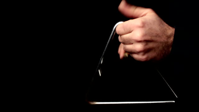 musician plays a rhythm with the triangle, percussion instrument - musikinstrument bildbanksvideor och videomaterial från bakom kulisserna