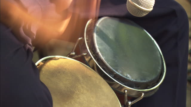 a musician plays the bongo drums. - trommel stock-videos und b-roll-filmmaterial