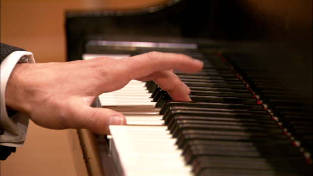 a musician plays the piano. - pianist stock-videos und b-roll-filmmaterial