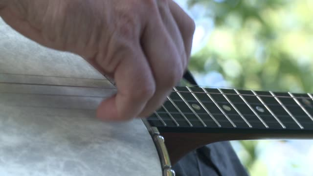 musician plays traditional country and folk on guitar and banjo - country and western stock videos and b-roll footage