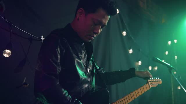 musician preparing perform in club. - music stock videos & royalty-free footage