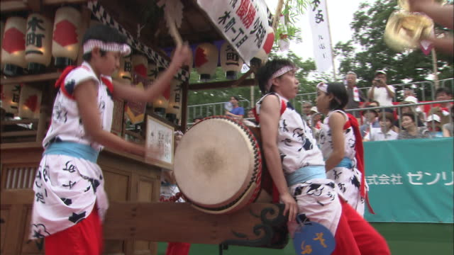 Musicians and other performers participate in the Kokura Gion Taiko festival parade.