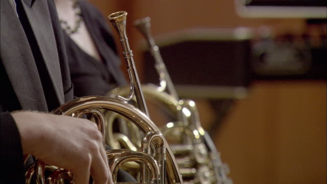 cu musicians holding french horns / london, united kingdom - tuxedo stock videos and b-roll footage