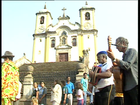 musicians in blue berets lead procession past foot of church steps ouro preto brazil - preto stock videos & royalty-free footage