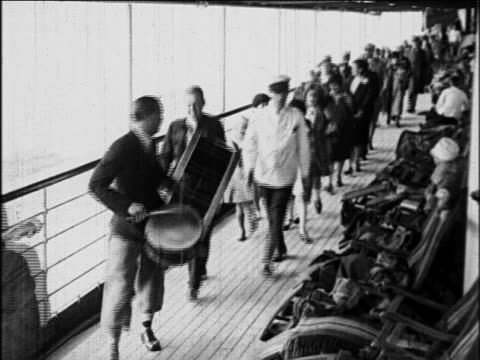 b/w 1929 musicians leading passengers in parade on deck of s.s. honolulu cruise ship / newsreel - performer stock videos & royalty-free footage