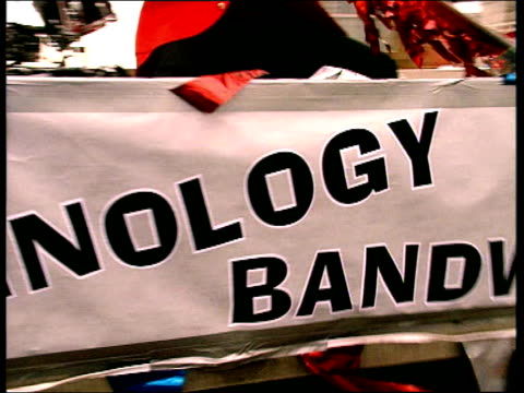 musicians of parody group technology bandwagon drive through streets of london on back of pick up truck playing drums banjo trumpet and tuba - satire stock videos & royalty-free footage