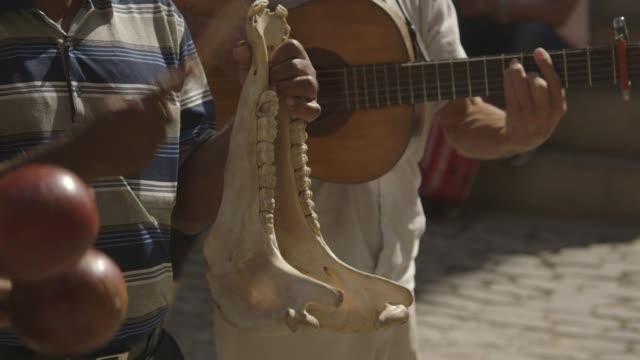 musicians on the streets of havana cuba on january 27th 2015 shots wide shot of six colorfully clothed musicians in a city square close shot of a man... - maraca stock videos & royalty-free footage