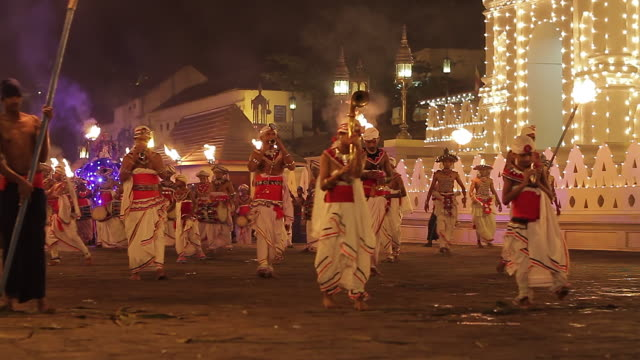 ms musicians performing in buddhist festival or procession 'esala perahera' in front of 'temple of tooth' audio / kandy, central province, sri lanka - sri lankan culture stock videos and b-roll footage