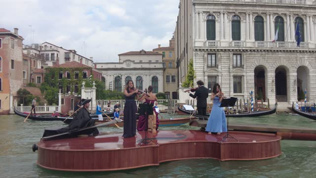 musicians play aboard the violin shaped boat during the grand canal parade on september 18, 2021 in venice, italy. violin shaped boat was launched on... - nautical vessel stock videos & royalty-free footage