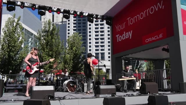 Musicians play music on a stage at the outdoor area of Oracle OpenWorld 2017 conference in San Francisco California US on Monday Oct 2 2017...