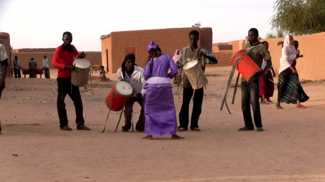 Musicians playing drums and woman dancing Niger Agadez
