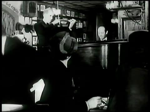 stockvideo's en b-roll-footage met musicians playing in small pub recorded music woman making selection walking away from juke box in small restaurant pub - 1943