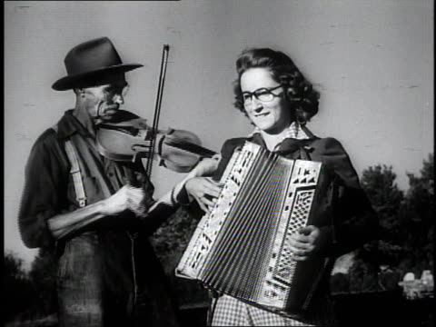 1950 montage musicians playing the fiddle and accordion while people watch / southville, kentucky, united states - country and western stock videos & royalty-free footage