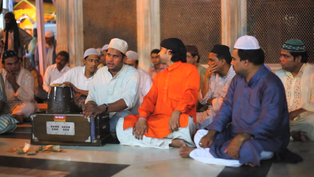 ms musicians singing at mausoleum in nizamuddin dargah / delhi, india   - mausoleum stock videos and b-roll footage