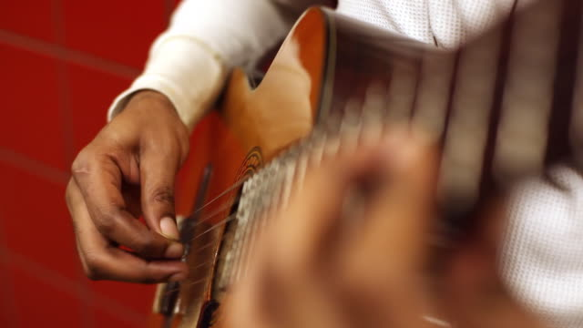 musician's skilled fingers pick acoustic guitar on new york city subway platform - musician stock videos & royalty-free footage