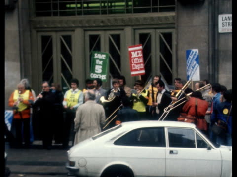 musicians strike; england: london: portland place exterior of broadcasting house musicians outside - some play instruments sign: 'sack the... - secretary general stock videos & royalty-free footage