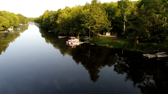 muskoka river - low angle to high over the water - cottage stock videos & royalty-free footage