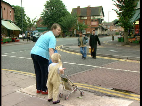 muslem campaign against prostitution england birmingham walsall heath ms man old man holding small boys hand as crossing road / ms asian boy and... - sack race stock videos & royalty-free footage