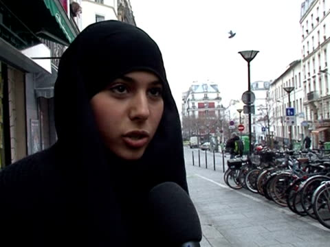 muslim and non-muslim residents in paris had mixed reactions on wednesday after a french parliament report called for a ban on the full islamic veil,... - hijab stock videos & royalty-free footage