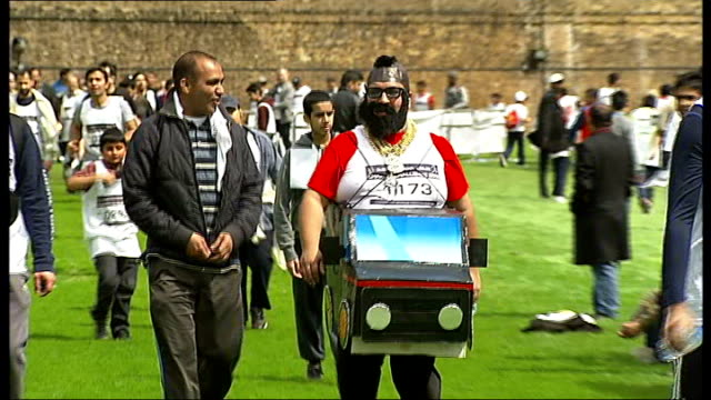 "muslim association stage charity run at the tower of london; participant dressed as mr t from ""the a team"" people taking part in fun run - participant stock videos & royalty-free footage"