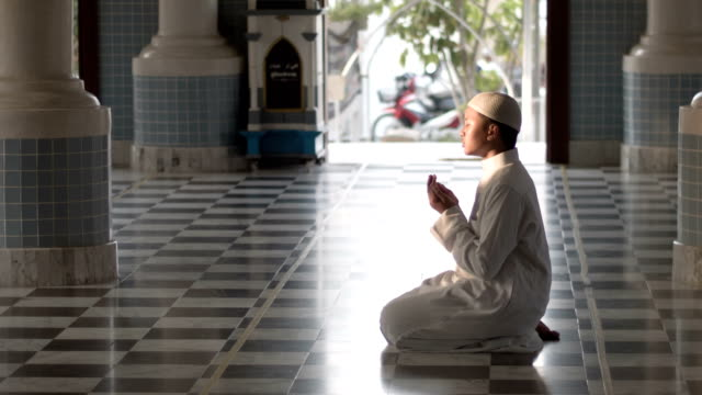 muslim boy praying in mosque - koran stock videos and b-roll footage