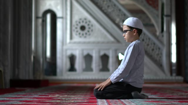 muslim boy praying in mosque - middle east stock videos & royalty-free footage
