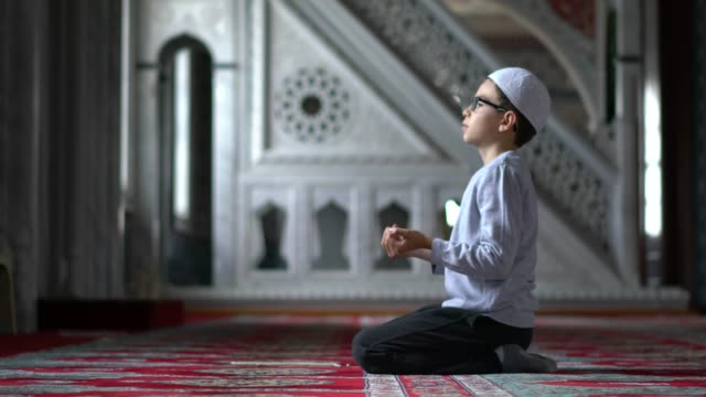 muslim boy praying in mosque - islam stock videos & royalty-free footage