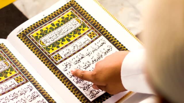 muslim boy reading al quran in mosque - koran stock videos & royalty-free footage